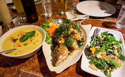 Curry soup and fresh fish in Kuraburi, Thailand. Photo via Flickr:Kent Wang
