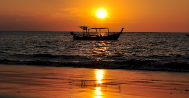 Sunsent in Khao Lak, Thailand. Photo via Flickr:Kullez