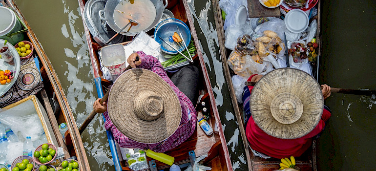Selling food boatside in Thailand. Photo via Flickr:Georgie Pauwels