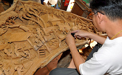 Carving wood in Thailand. Photo via Flickr:Dennis Jarvis
