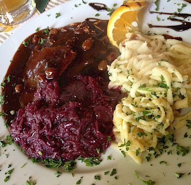 Sauerbraten and Spatzle at the Weinzerstuber Restaurant, Koblenz. Photo via Flickr:corsi photo