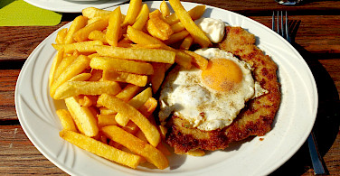 Schnitzel mit Speigelei, a favorite in Germany. Photo via Flickr:Thomas Kohler