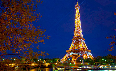 Eiffel Tower all aglow in beautiful Paris, France! Biking in the City of Light, woohoo! Photo via Flickr:Moyan Brenn