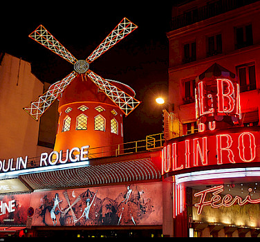 Moulin Rouge in Paris. Photo via Flickr:Moyan Brenn