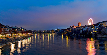 Rhine River all aglow in Basel. Photo via Flickr:Tambako The Jaguar