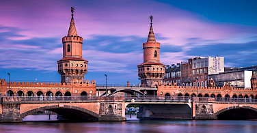 Oberbaumbrücke over Spree River in Berlin, Germany. Photo via Flickr:Thomas