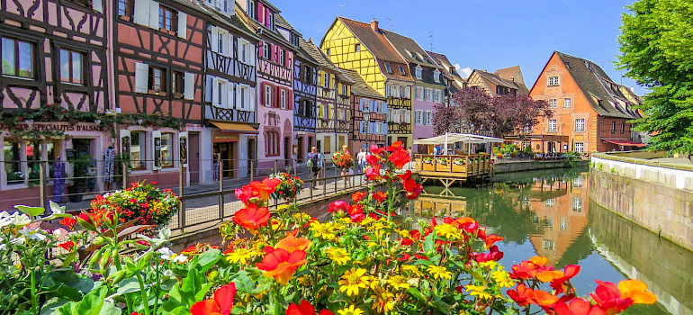 Biking along the canal in Colmar, Alsace, France. Photo via Flickr:Kiefer