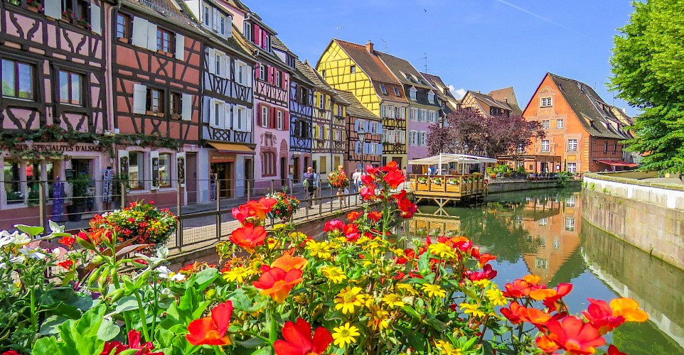 Biking along the canal in Colmar, Alsace, France. Flickr:Kiefer