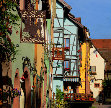 Bike rest in Riquewihr, Alsace Wine Route Tour, France. Photo via Flickr:Pug Girl