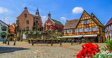 Cozy square in Eguisheim, known for its great Alsatian wines, Alsace, France. Photo via Flickr:Kiefer