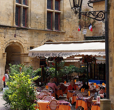 Off the bike for a cafe stop in Sarlat, France. Photo via Flickr:Mike Fleming