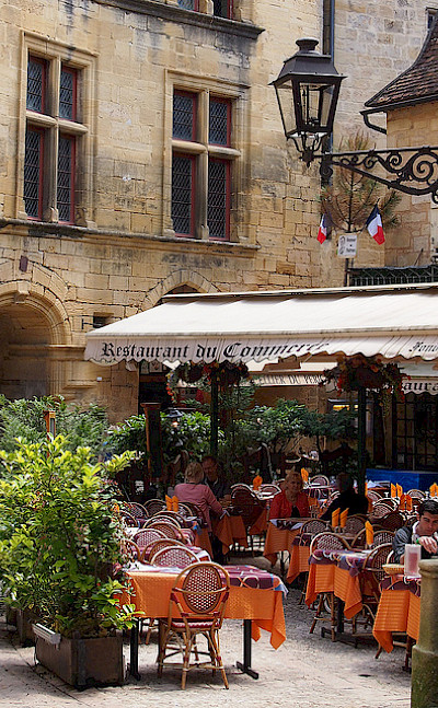 Off the bike for a cafe stop in Sarlat, France. Flickr:Mike Fleming