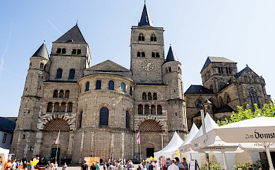 Romanesque facades at St Peter's Cathedral in Trier, Germany. Flickr:Les Williams