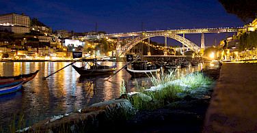 Wine boats on the Duoro River near Ponte Dom Luis in Porto, Portugal. Photo via Flickr:Chris Stephenson