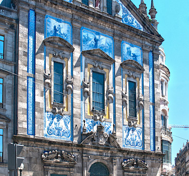 Gorgeous tiled buildings in Porto, Portugal. Photo via Flickr:Berit Watkin