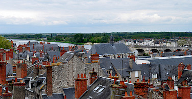Notice the characteristic gray roofs and red chimneys in Blois, France. Photo via Flickr:Frederique Voisin-Demery