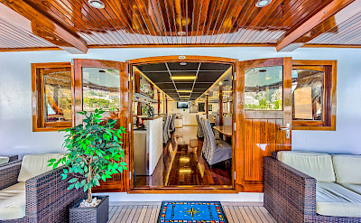 Deck Lounge looking into Dining Room - Melody - Bike & Boat Tours