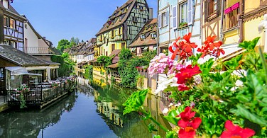 Along the canal in Colmar, Alsace, France. Photo via Wikimedia Commons:xiyangxing