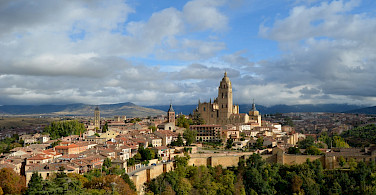 Overlooking Segovia Cathedral, the Guadarrama Mountains and the 8th-century city walls. Flickr:Pedro