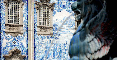 Famous old blue tiles in Porto, Portugal. Photo via Flickr:YellowCat