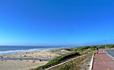 Cycling along the beach close to São Pedro Moel Village, Portugal. Photo via TO