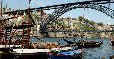Old wine barrel carrying vessels in Porto, Portugal. Photo via Flickr:Lau Svensson