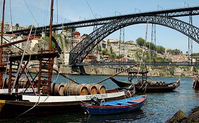 Old wine barrel carrying vessels in Porto, Portugal. Photo via Flickr:Lau Svensson