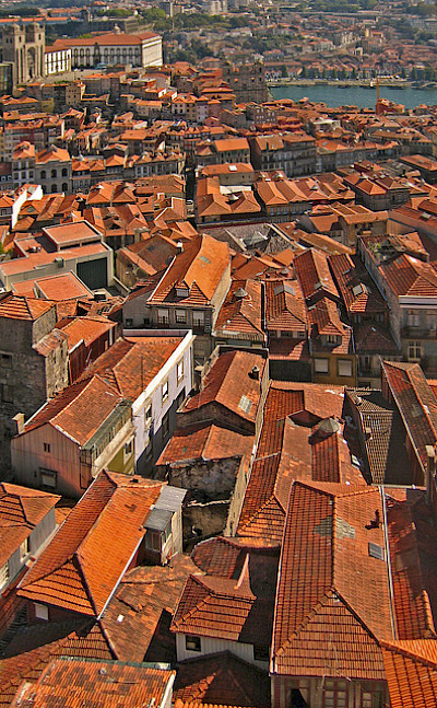 Rooftops in Porto along the Douro River, Portugal. Photo via Flickr:HarshilShah