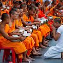 Almsgiving ceremony for monks in Bangkok, Thailand. Photo via Flickr:Mark Fischer