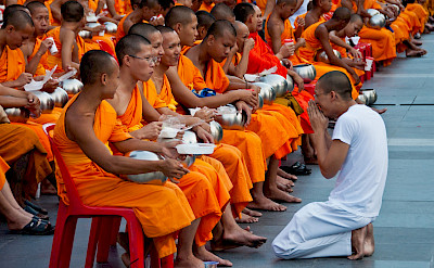 Almsgiving ceremony for monks in Bangkok, Thailand. Photo via Flickr:Mark Fischer
