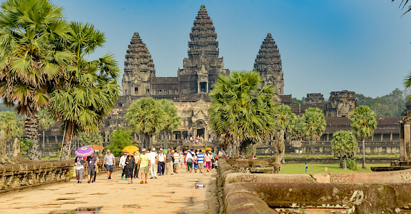 Tourists at Angkor Wat in Siem Reap, Cambodia. Photo via Flickr:Xiquinho Silva