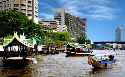 Chao Phraya River boat cruises in Bangkok, Thailand. Photo via Flickr:Bernard Spragg NZ