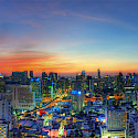 Setting sun in Bangkok, Thailand. Photo via Flickr:Mike Behnken