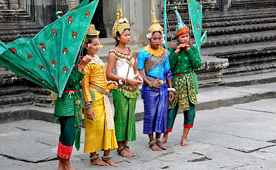 Cambodian girls at Siem Reap dressed for ceremony. Photo via Flickr:Dennis Jarvis