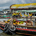Floating markets on the Mekong River in Vietnam and Cambodia. Photo via Flickr:RjabalosIII