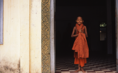 Little monk in Siem Reap, Cambodia. Photo via Flickr:totalitarism