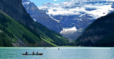 Canoers on Lake Louise, Banff National Park, Alberta, Canada. Photo via Flickr:Joseph