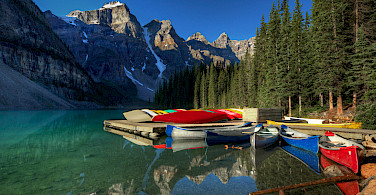Canoes on Lake Moraine at the Valley of the Ten Peaks, Alberta, Canada. Photo via Flickr:edwademd