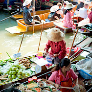 Ladies selling food at the Floating Market near Bangkok, Thailand. Photo via Flickr:Colin Tsoi