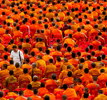 Monks at the annual Almsgiving Ceremony, Bangkok. Photo via Flickr:Mark Fischer