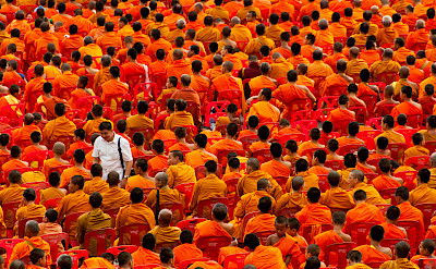 Monks at the annual Almsgiving Ceremony, Bangkok, Thailand. Photo via Flickr:Mark Fischer