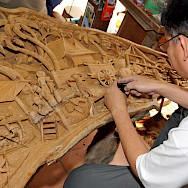 Intricate woodworker in Thailand. Photo via Flickr:Dennis Jarvis