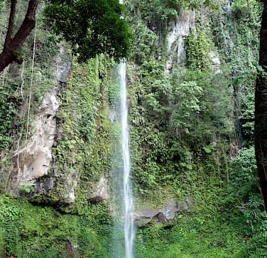 Katibawasan Falls, southeast of Mambajao, Camiguin, the Philippines. Photo via Flickr:Allan Ascano