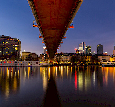 Bike & Boat underneath the bridge in Frankfurt-am-Main, Bavaria, Germany. Photo via Flickr:Carsten Frenzl