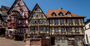 Colorful half-timbered houses in the square in Miltenberg. Photo via Flickr:Carsten Frenzl
