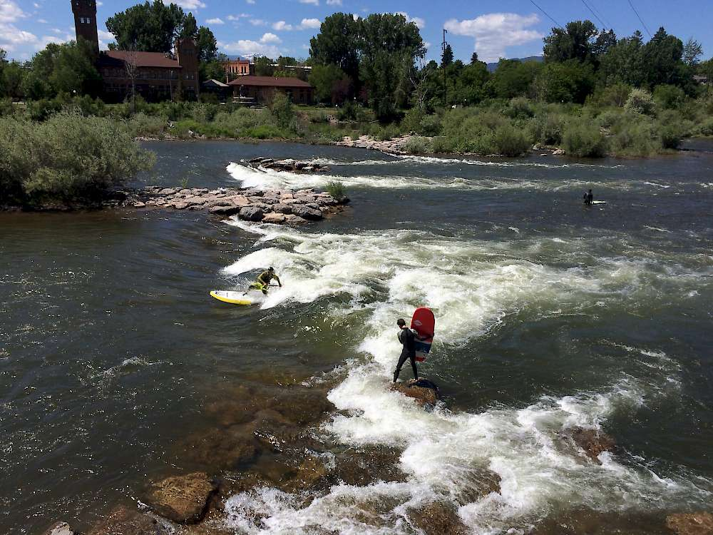 Surfing on the rapids near Caras Park on the Clark Fork River