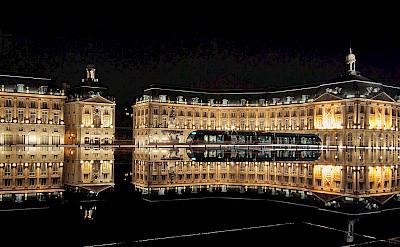 Place de la Bourse with Miroir d'eau and the tram, Bordeaux, France. Photo via Wikimedia Commons:Phillip Maiwald