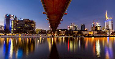 Bright city lights in Frankfurt on the Main River. Photo via Flickr:Carsten Frenzl