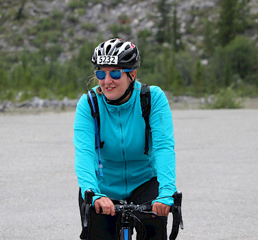 Anna sporting a big smile after a long climb.