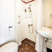 Bathroom with shower, toilet and sink